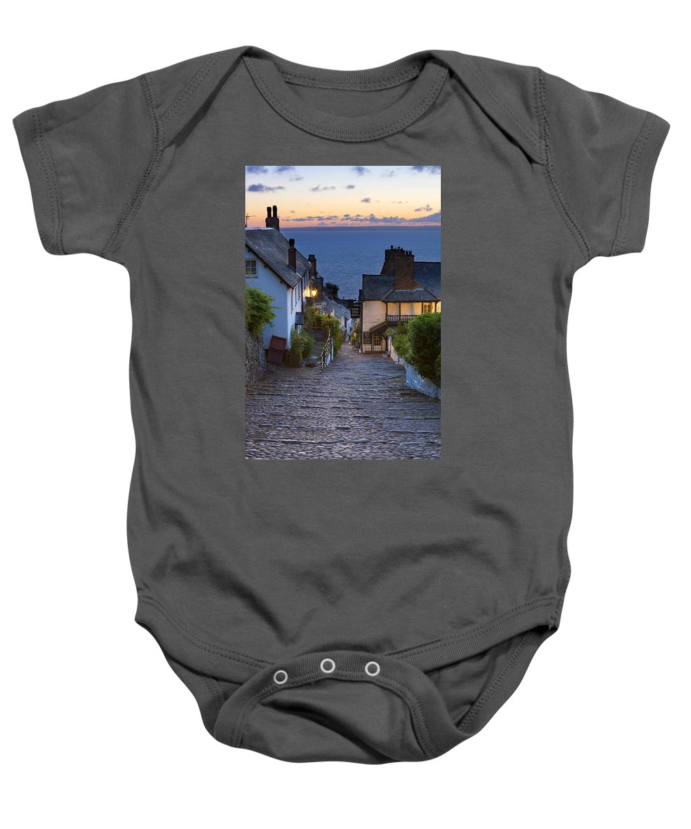 Attraction Baby Onesie featuring the photograph Clovelly by Sebastian Wasek