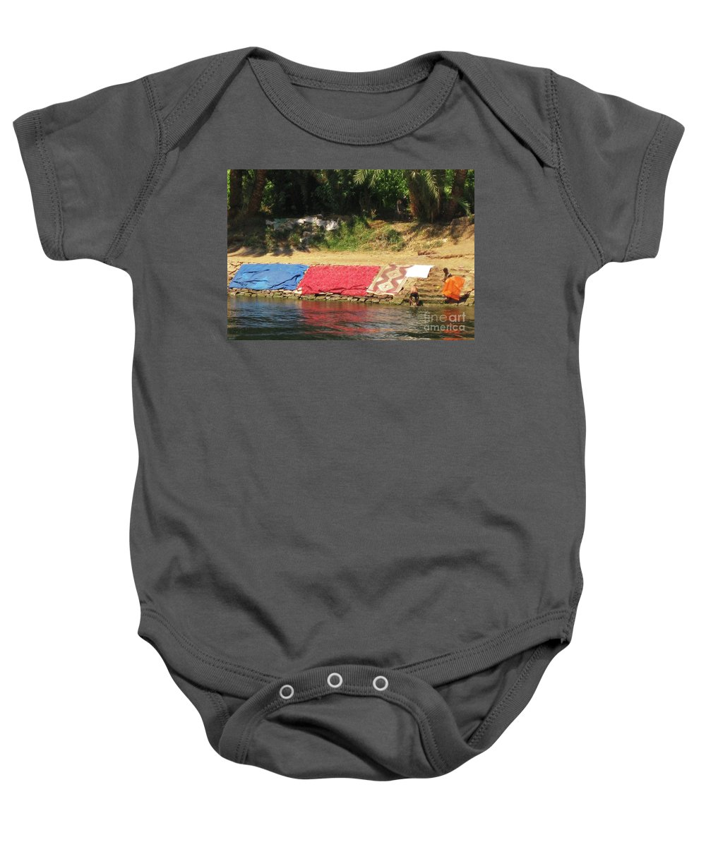 Nile River Baby Onesie featuring the painting Laundry Matt On The Nile by John Malone