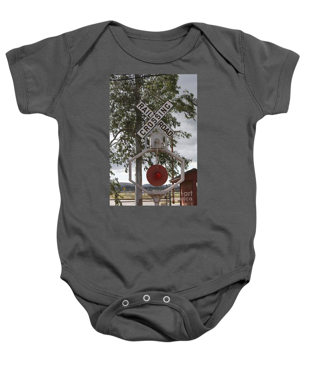 Railroad Baby Onesie featuring the photograph The Cossing by Tommy Anderson