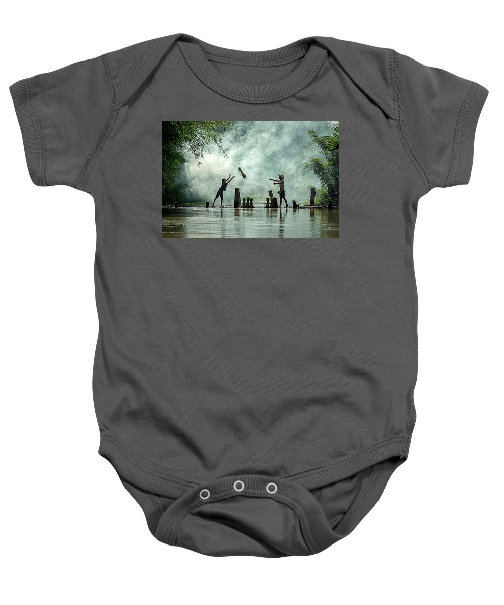 Rice Baby Onesie featuring the photograph Asian Farmers Earn Rice Fields by Somchai Sanvongchaiya