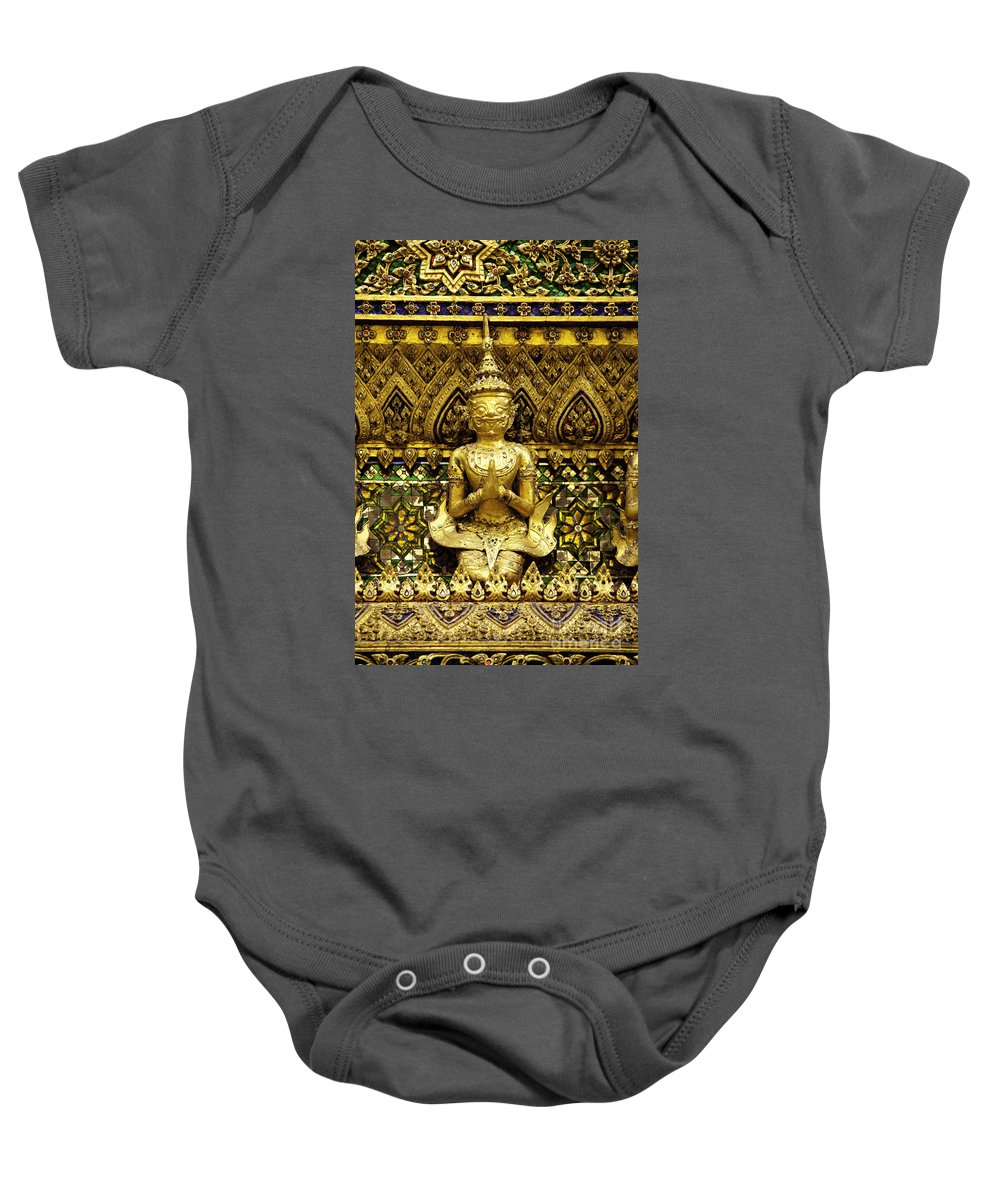 Artifact Baby Onesie featuring the photograph Detail From A Buddhist Temple In Bangkok Thailand by Anthony Totah