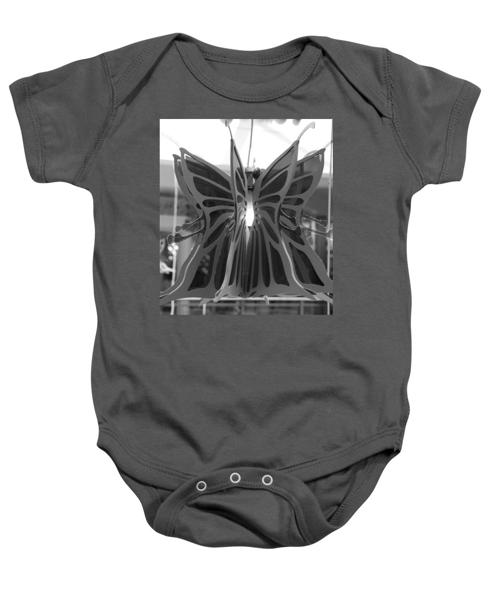 Black And White Baby Onesie featuring the photograph Hanging Butterfly by Rob Hans