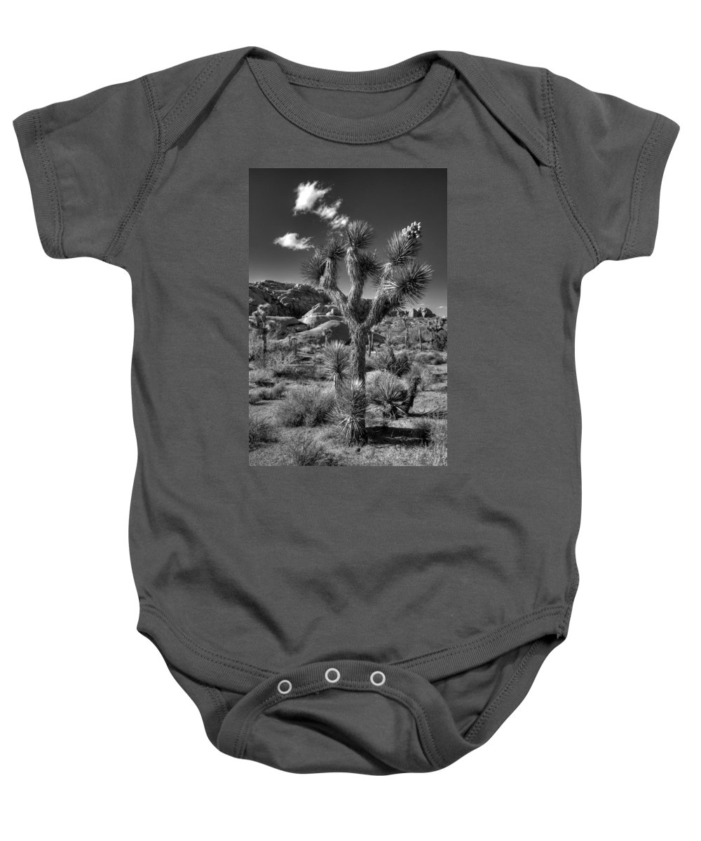 Black & White Baby Onesie featuring the photograph Joshua Tree And Cloud by Peter Tellone