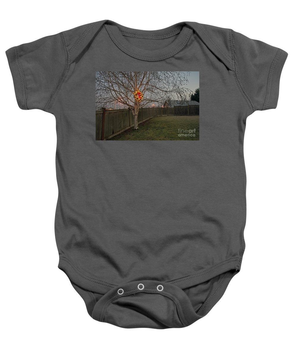 December Baby Onesie featuring the photograph Lit Christmas Wreath Hanging In Tree by Jim Corwin
