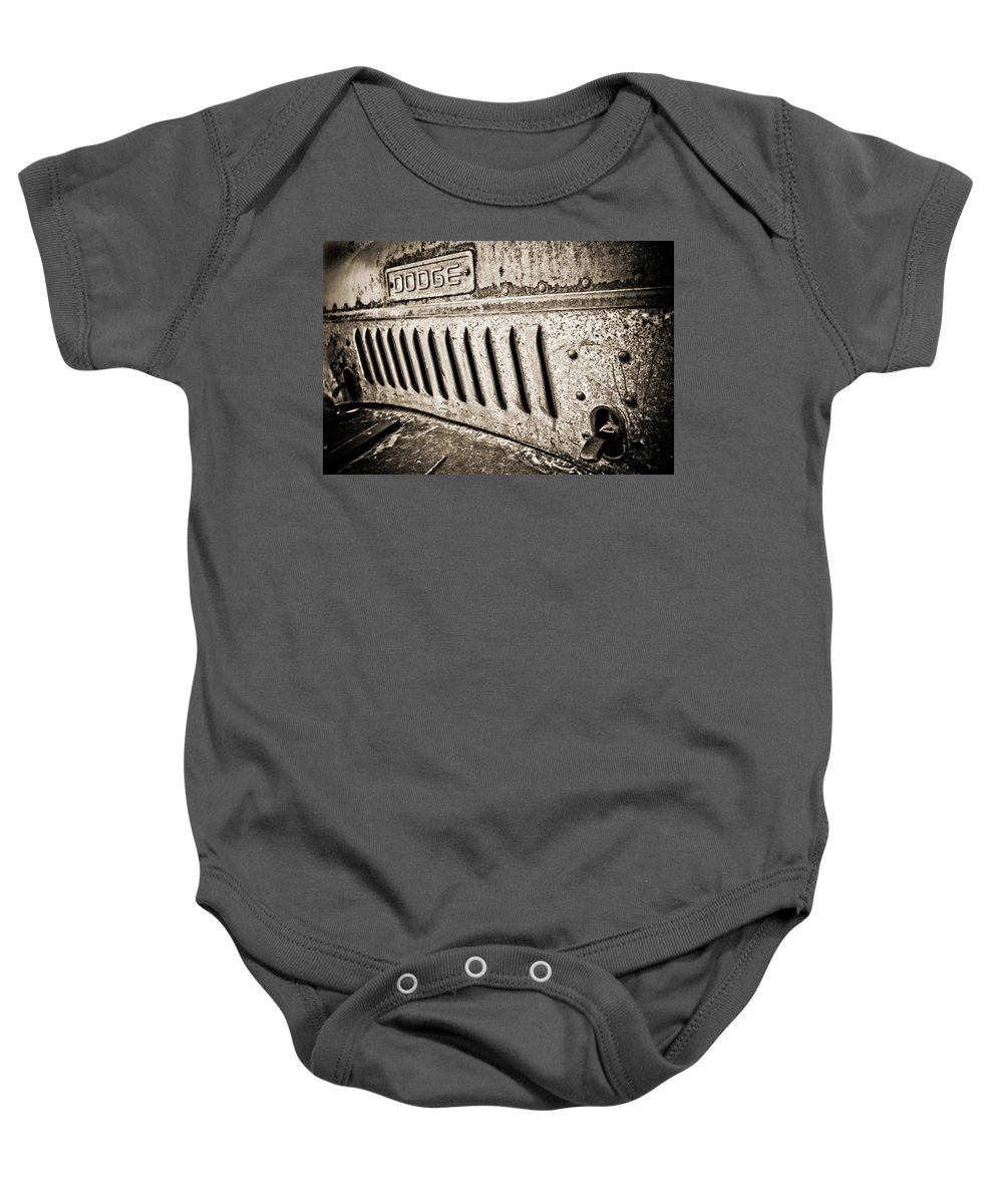 Car Baby Onesie featuring the photograph Old Dodge Grille by Marilyn Hunt