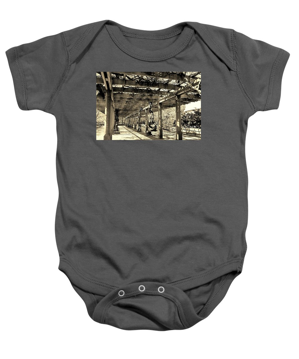 Central Park Baby Onesie featuring the photograph Under The Vines by Catie Canetti