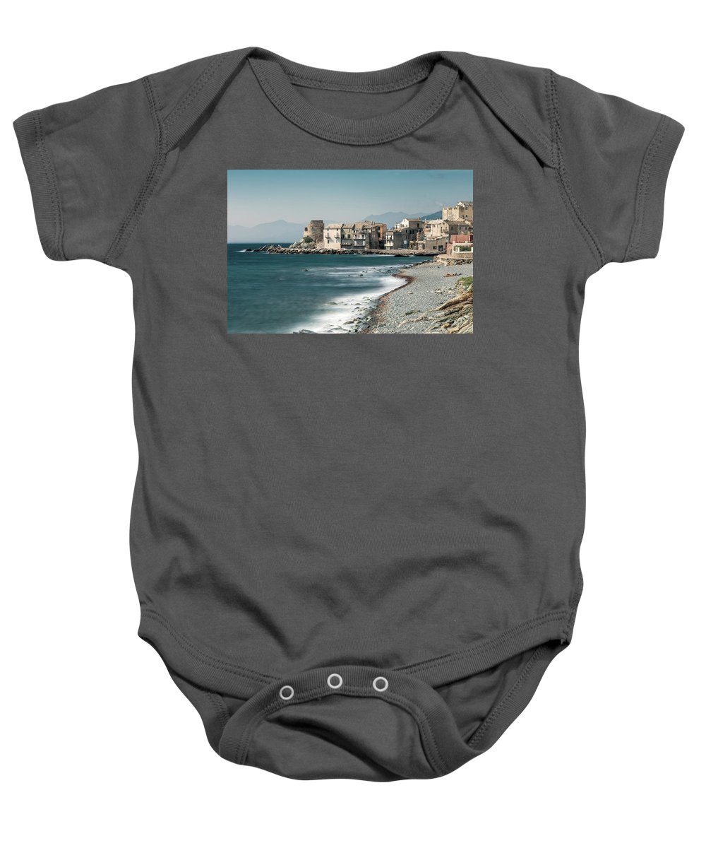 Blue Baby Onesie featuring the photograph Village And Shingle Beach Of Erbalunga In Corsica by Jon Ingall