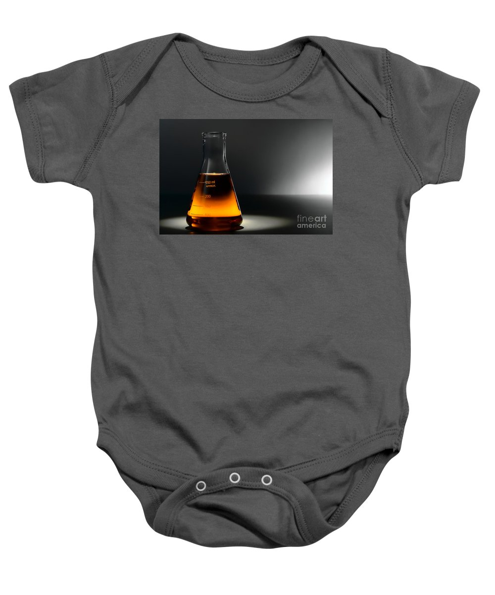 Amber Baby Onesie featuring the photograph Laboratory Equipment In Science Research Lab by Olivier Le Queinec