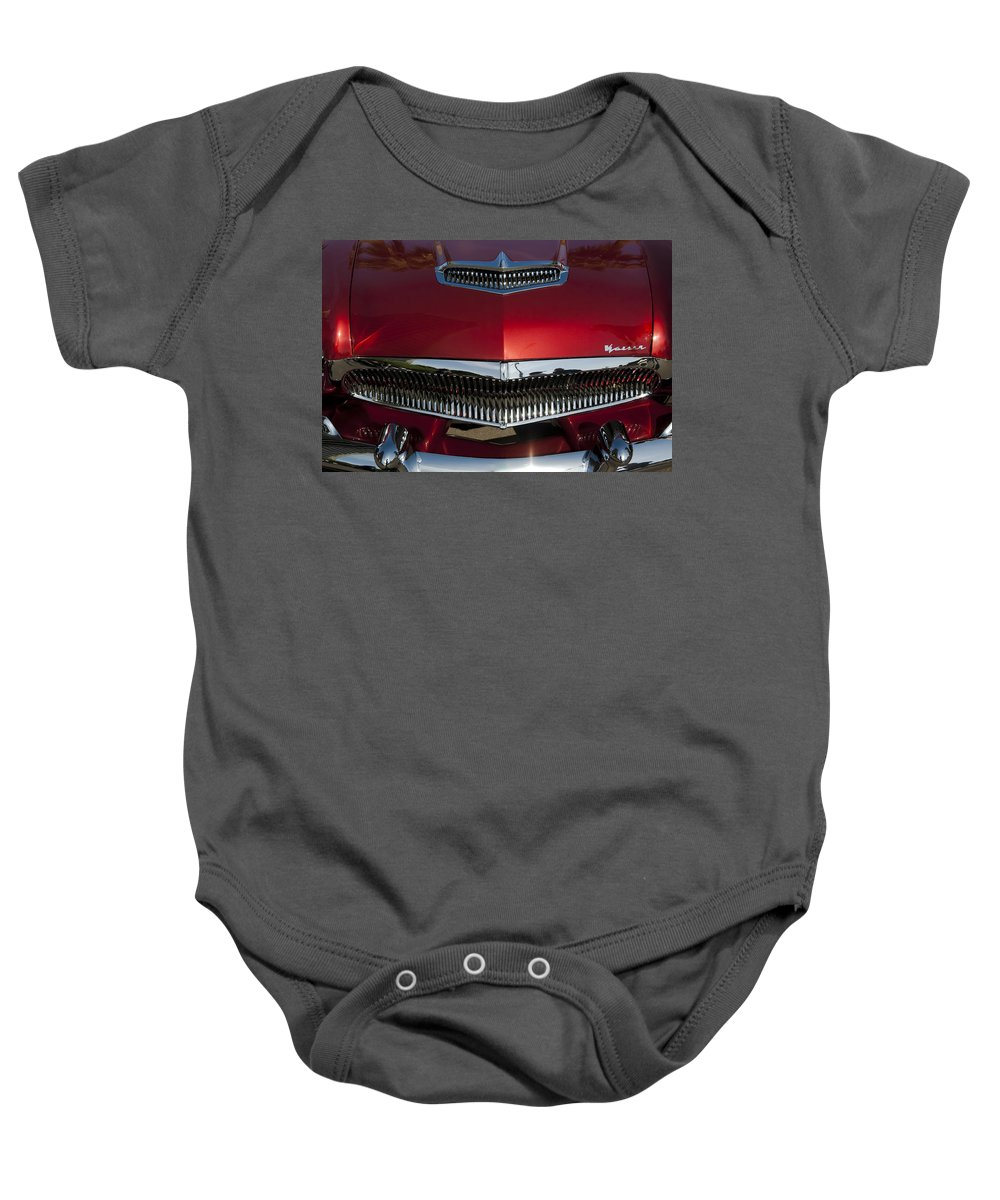 1955 Kaiser Baby Onesie featuring the photograph 1955 Kaiser Hood Ornament And Grille by Jill Reger