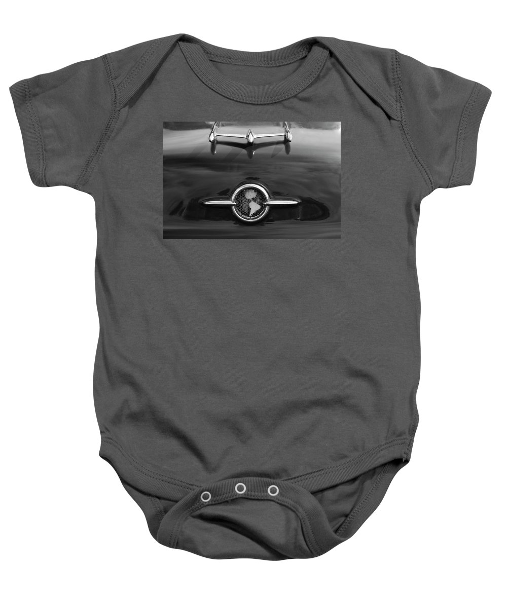 1955 Oldsmobile Holiday 88 Baby Onesie featuring the photograph 1955 Oldsmobile Holiday 88 Hood Ornament 2 by Jill Reger