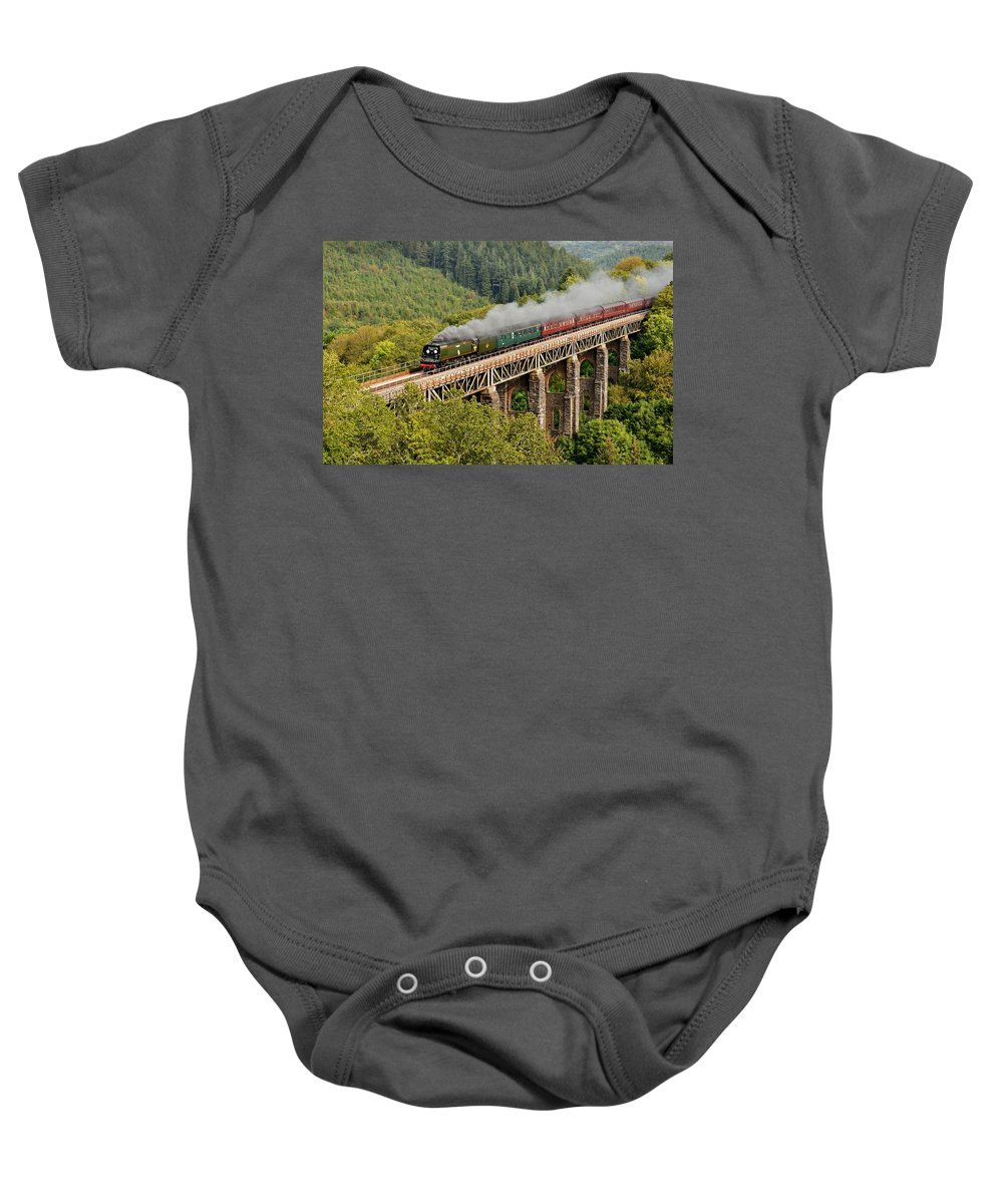 Steam Baby Onesie featuring the photograph 34067 Tangmere Crossing St Pinnock Viaduct. by Ashley Jackson