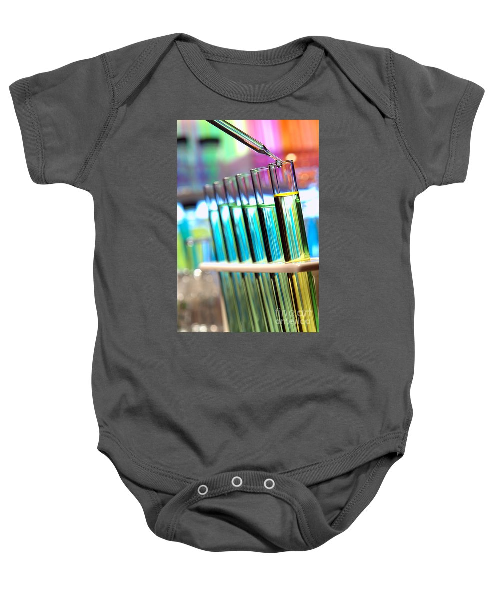 Chemical Baby Onesie featuring the photograph Laboratory Experiment In Science Research Lab by Olivier Le Queinec