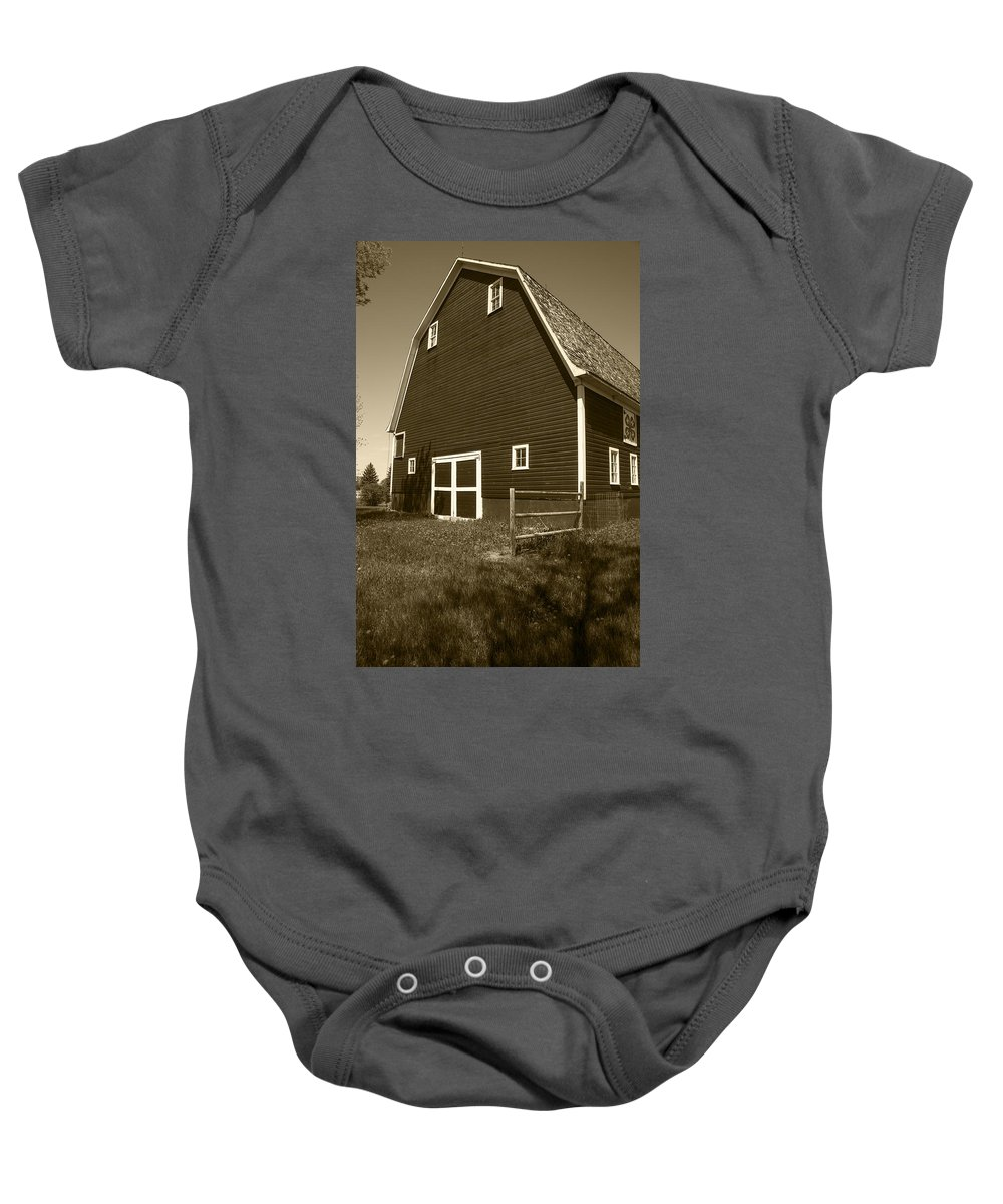 Barn Baby Onesie featuring the photograph Barn And Wild Flowers Sepia by Donald Erickson