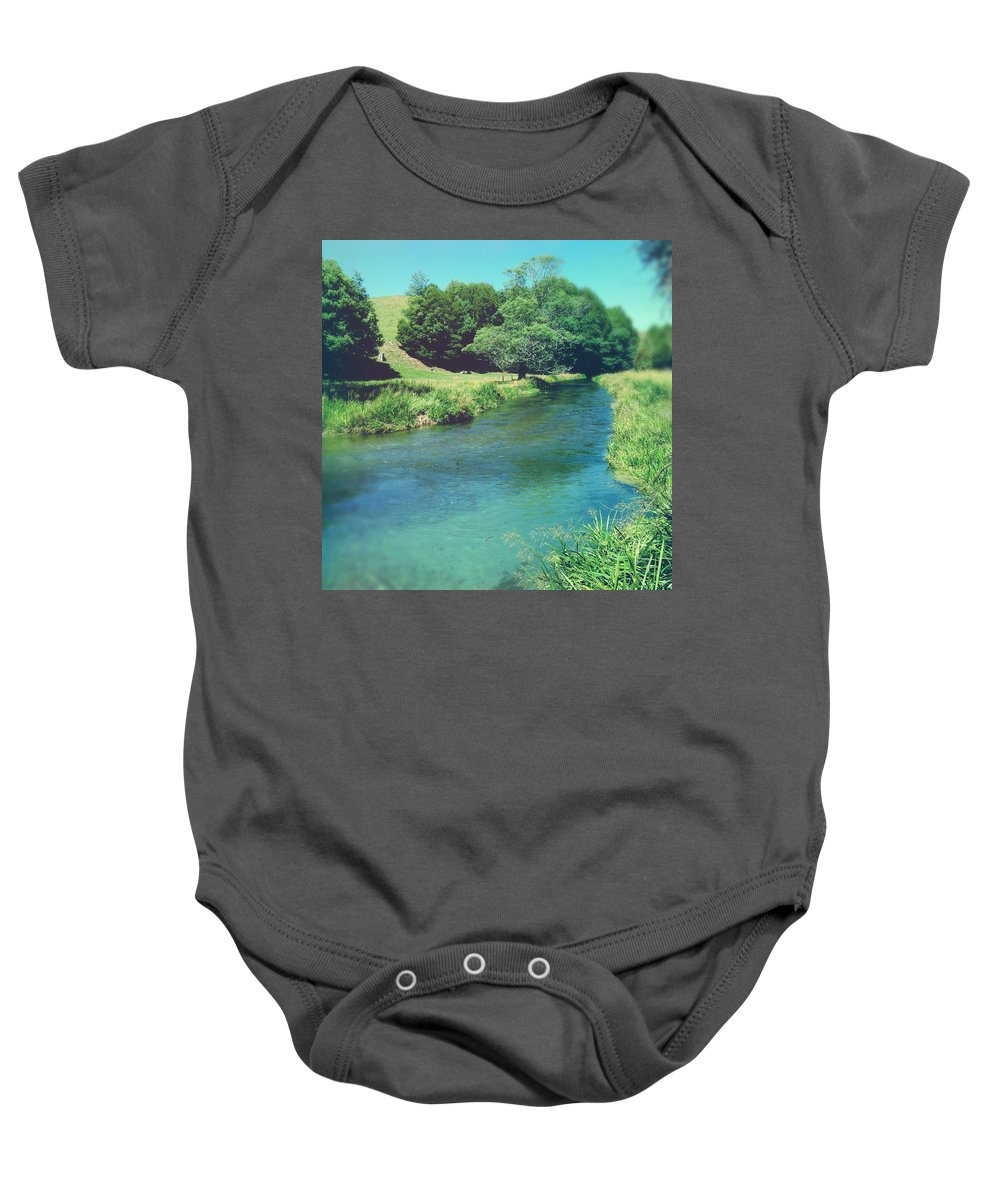 Blue Baby Onesie featuring the photograph Spring Water by Les Cunliffe
