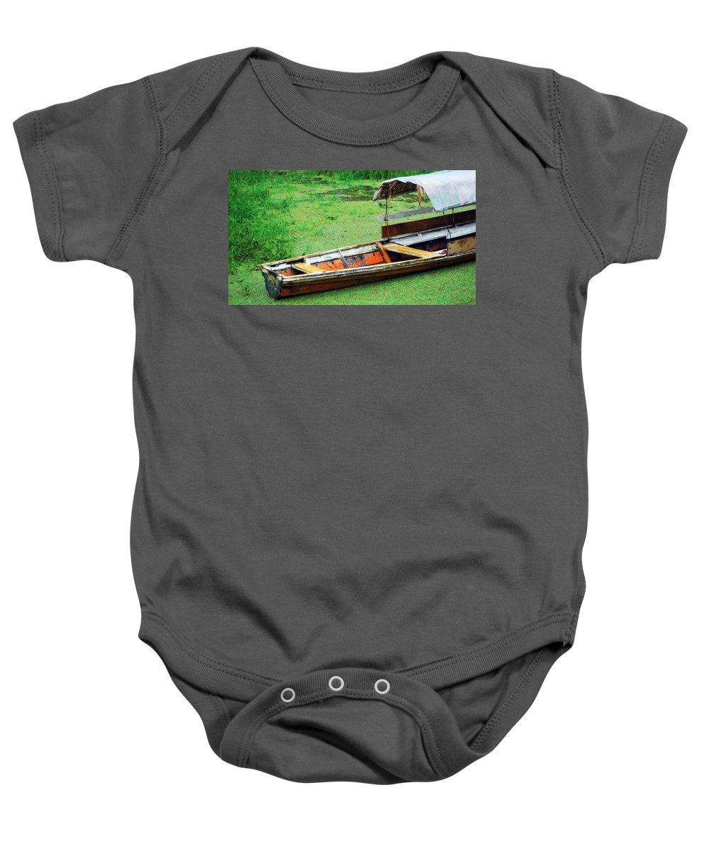Dangerous Baby Onesie featuring the photograph A Boat On Amazon Green Water by HQ Photo
