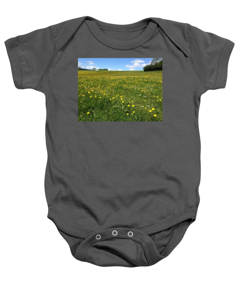 Field Baby Onesie featuring the photograph A Field Of Buttercups by Wendy Davies