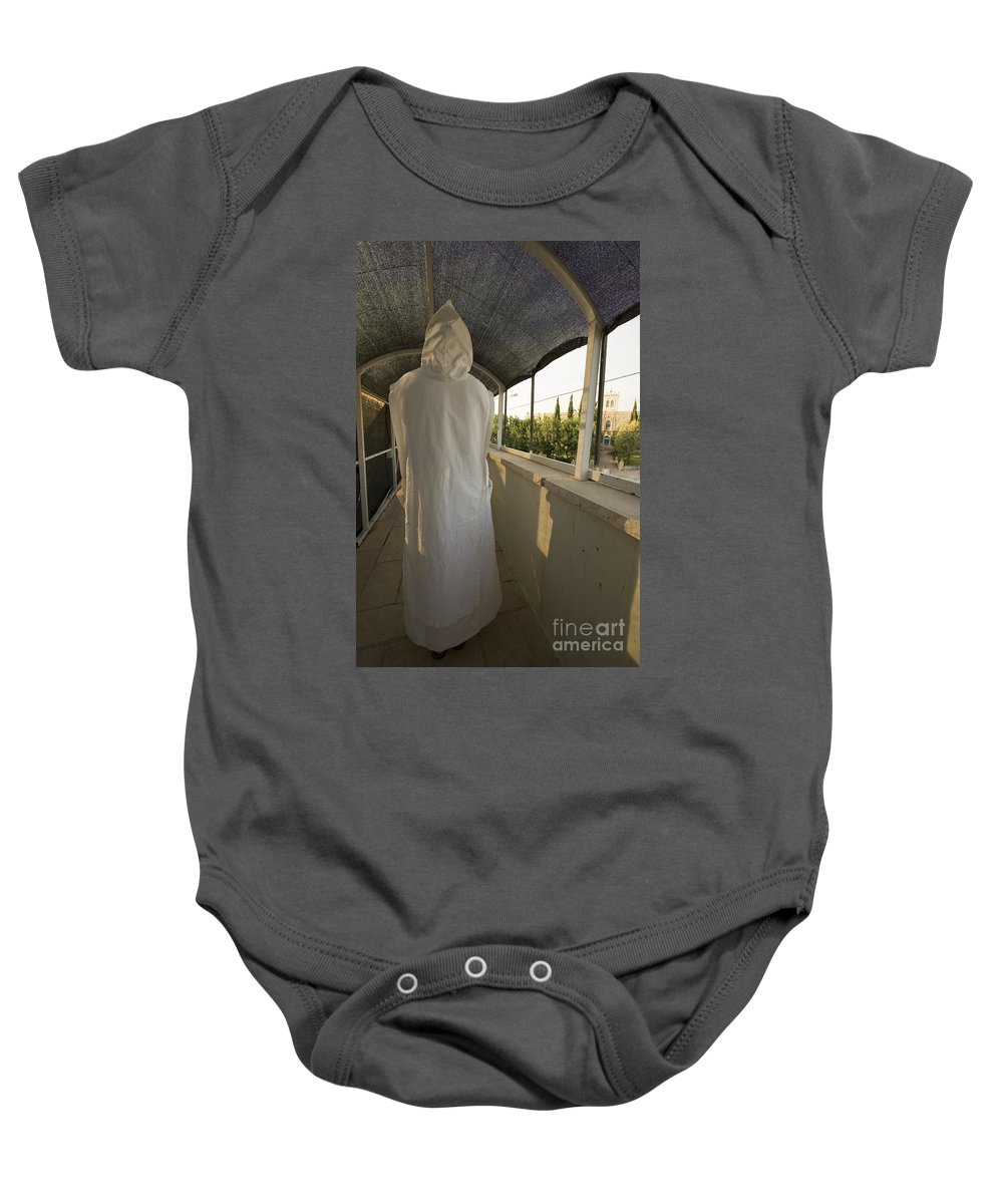 Nun Baby Onesie featuring the photograph A Nun In A Monastery by Danny Yanai