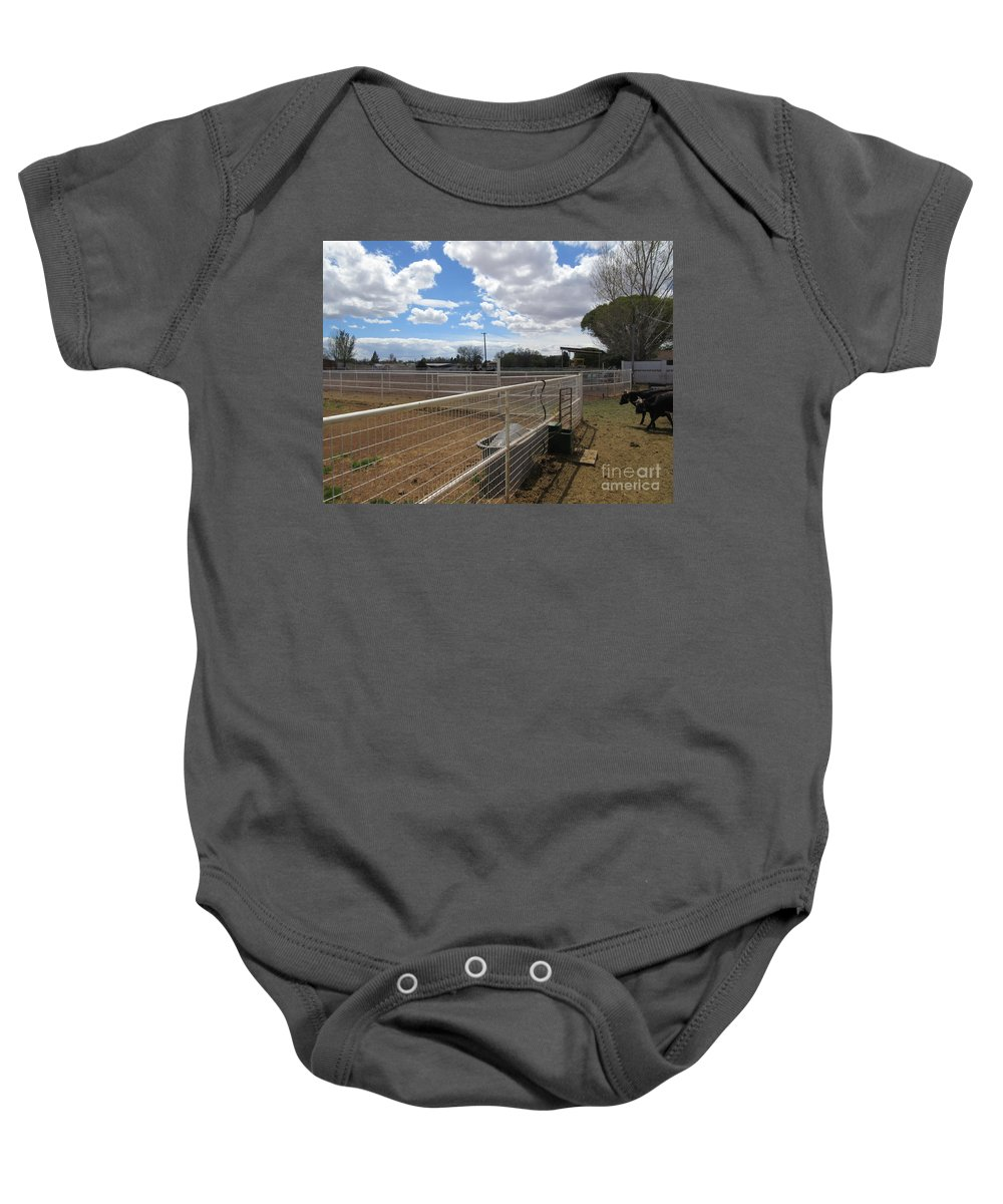 A Baby Onesie featuring the photograph A Ranch Scene by Frederick Holiday