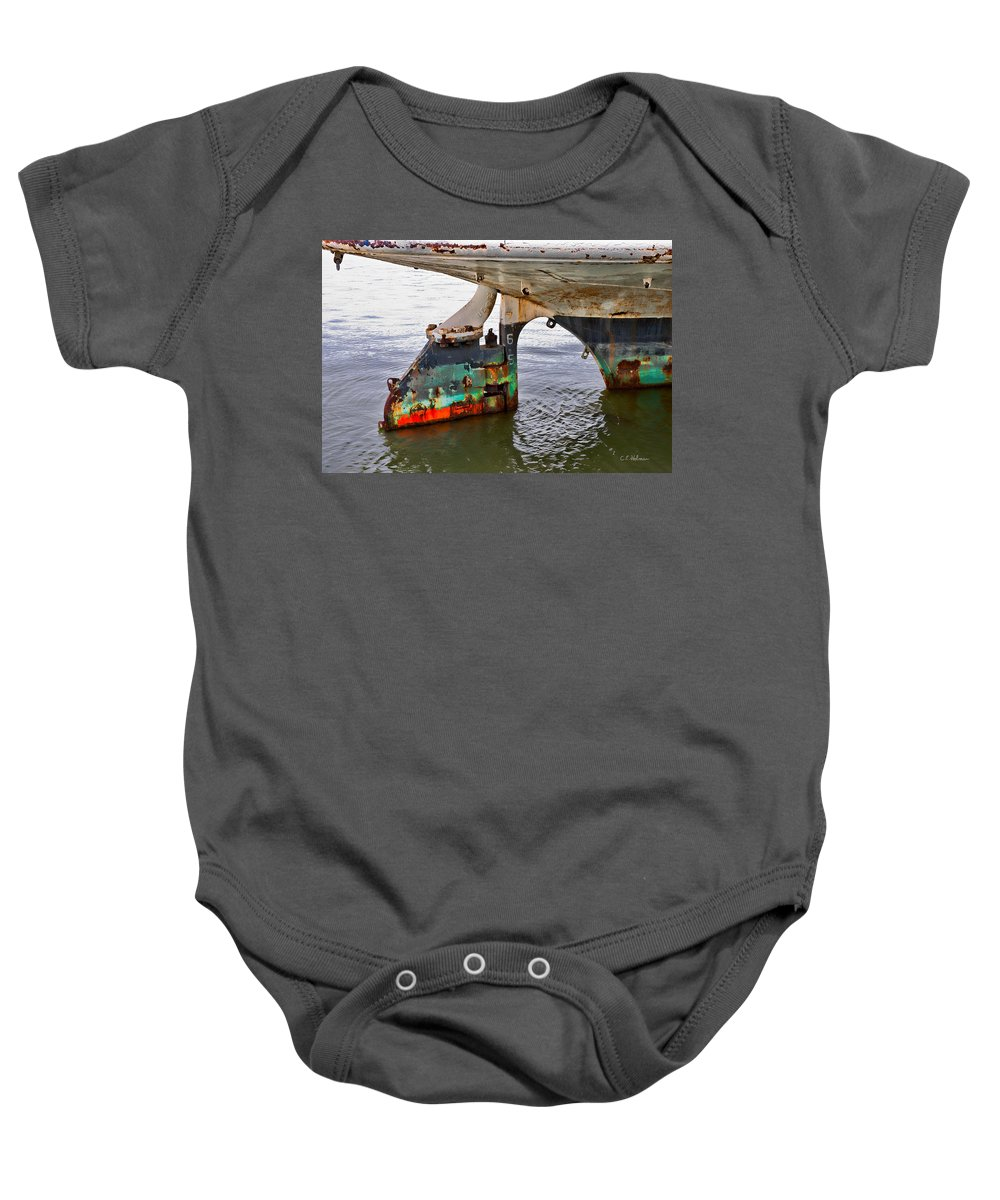 Boat Baby Onesie featuring the photograph A Rudder Of Many Colors by Christopher Holmes