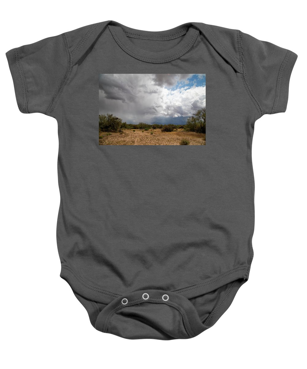 Arizona Baby Onesie featuring the photograph A Stormy Desert Sky by Cathy Franklin