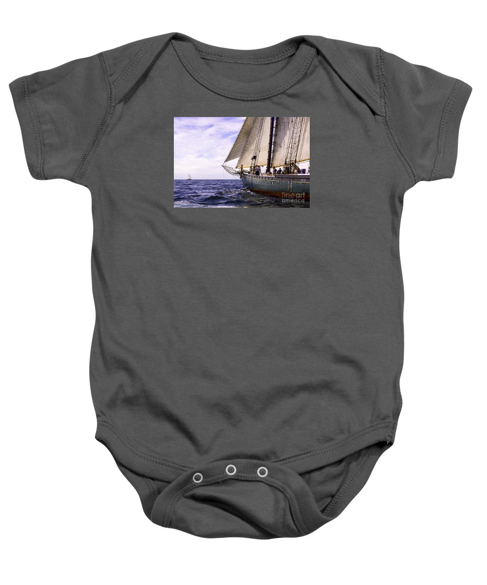 Amistad Baby Onesie featuring the photograph Aboard The Adventurer by Joe Geraci