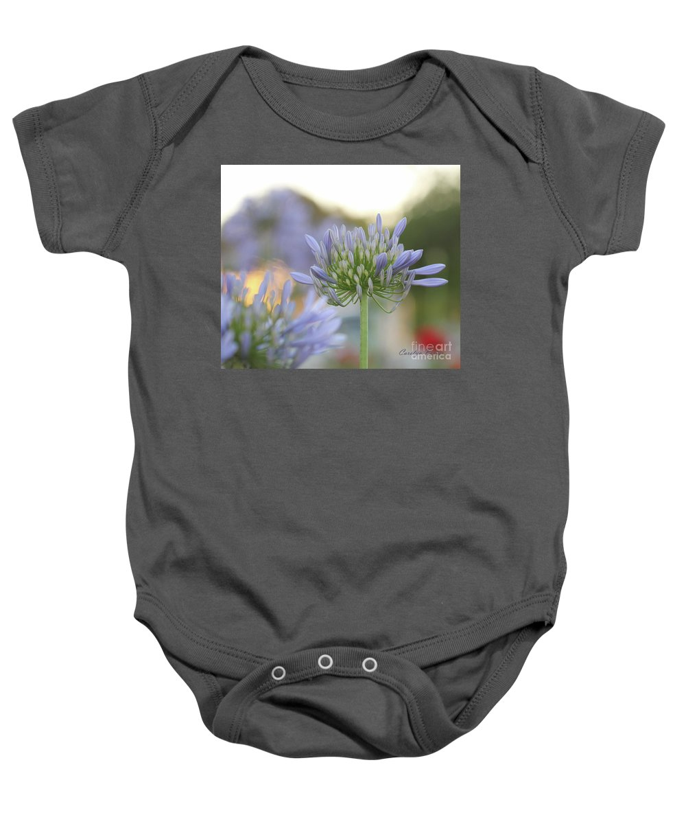 Purple Flower Baby Onesie featuring the photograph Agapanthus Africanus - Lily Of The Nile by Carolyn Parker