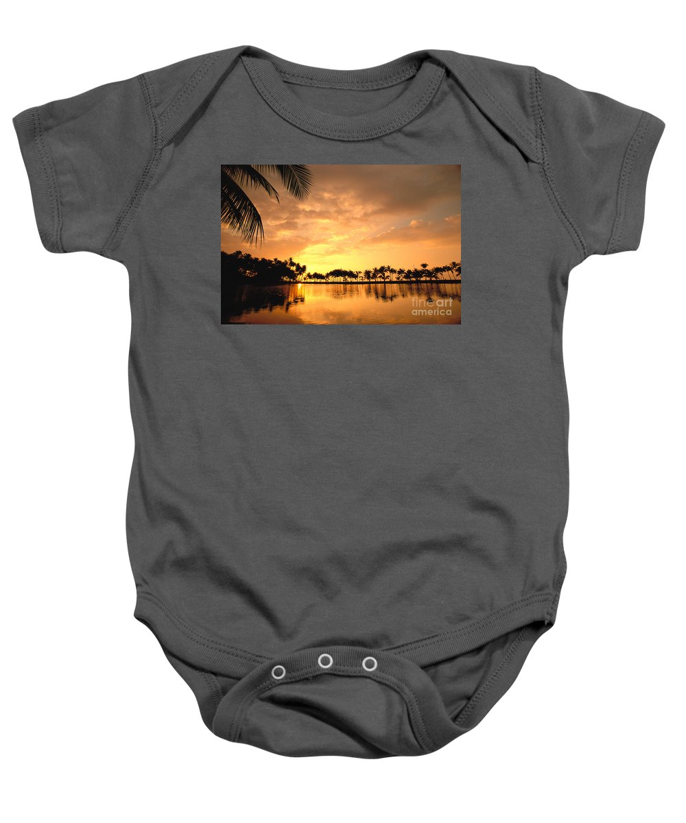 Anaeho'omalu Baby Onesie featuring the photograph Anaehoomalu Bay Sunset by William Waterfall - Printscapes