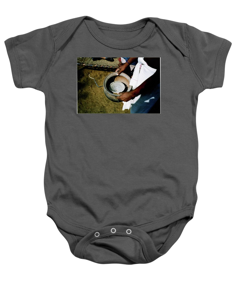 Alcohol Baby Onesie featuring the photograph Ancient Device by Ujjwal Rout