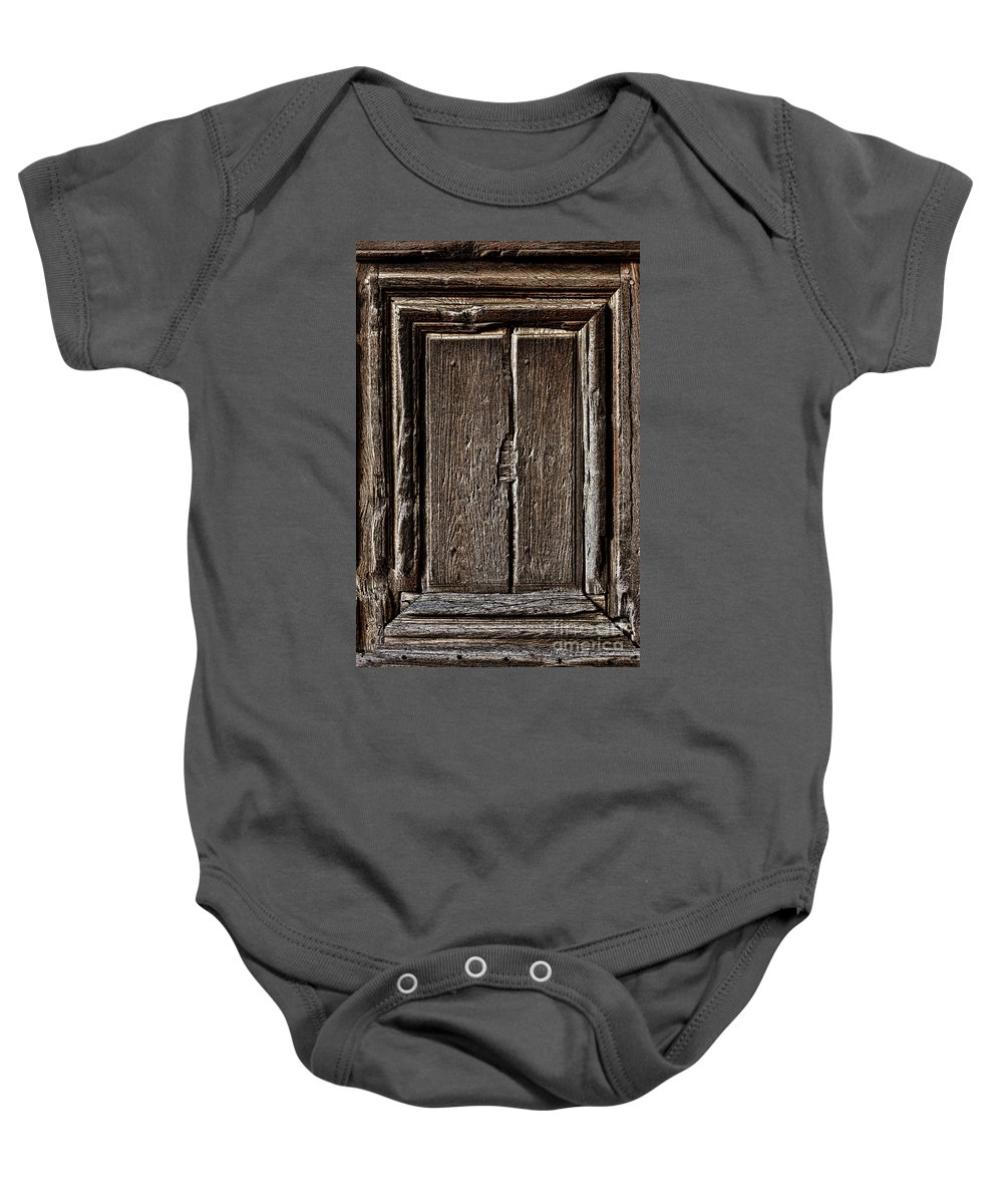 Wood Baby Onesie featuring the photograph Antique Wood Door Panel by Olivier Le Queinec
