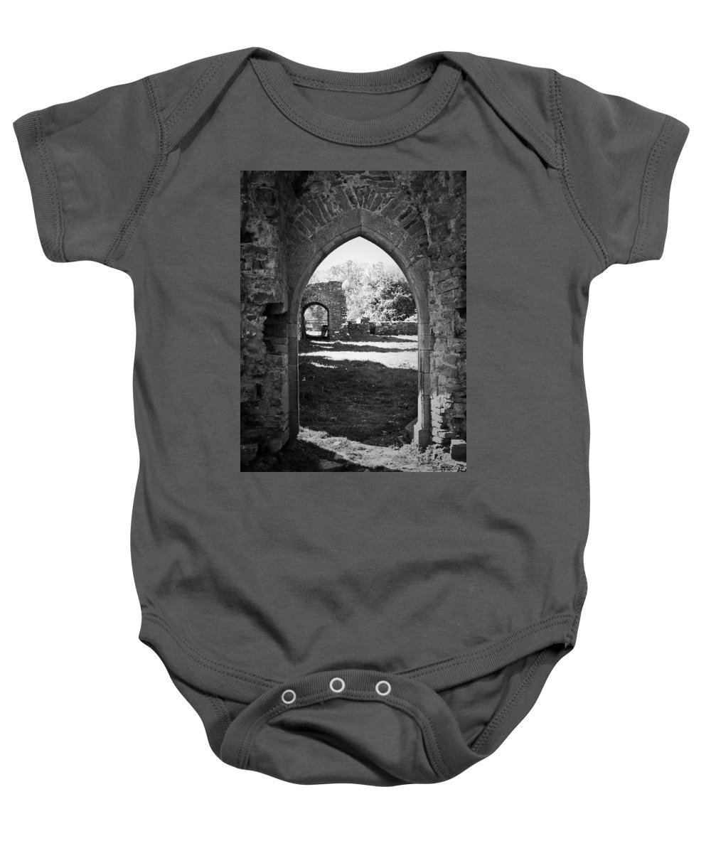 Irish Baby Onesie featuring the photograph Arched Door At Ballybeg Priory In Buttevant Ireland by Teresa Mucha