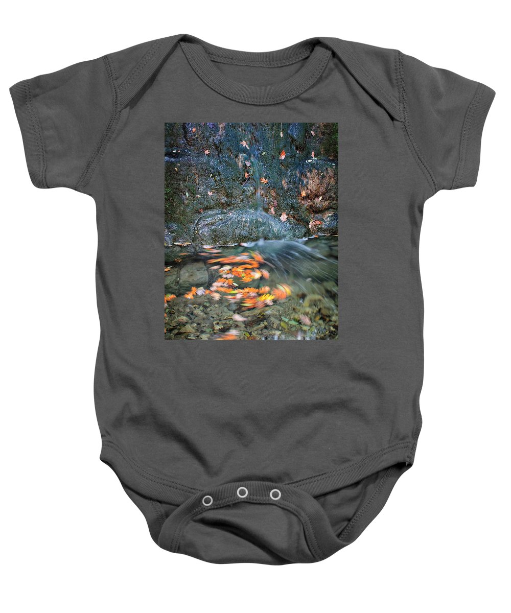 Sunset Baby Onesie featuring the photograph Autumn Leaves In Waterfall by Matteo Urbani