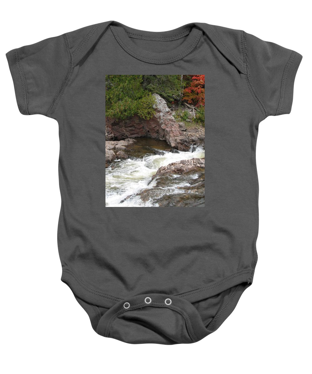 River Baby Onesie featuring the photograph Babbling by Kelly Mezzapelle