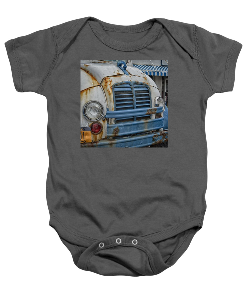Divco Baby Onesie featuring the photograph Badly Bruised Divco by Guy Whiteley
