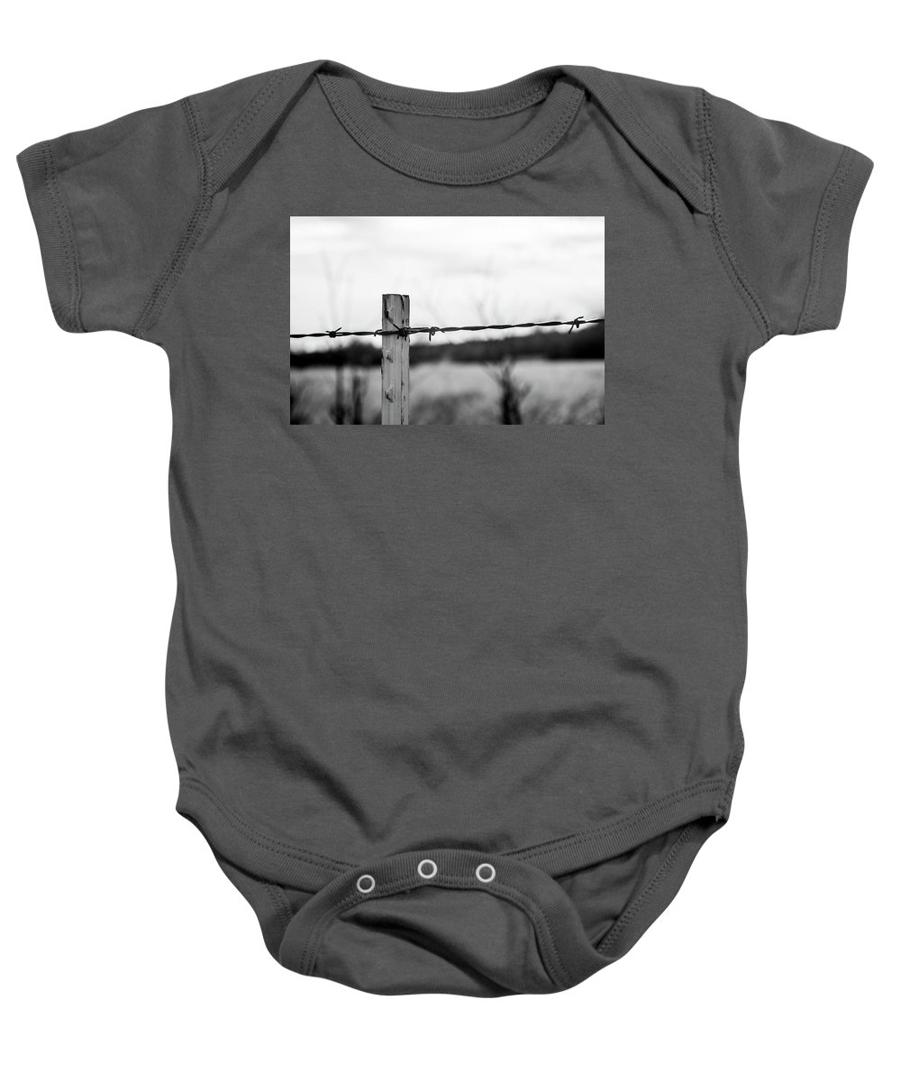Nature Baby Onesie featuring the photograph Barb-wire Fence by Gary Armstrong