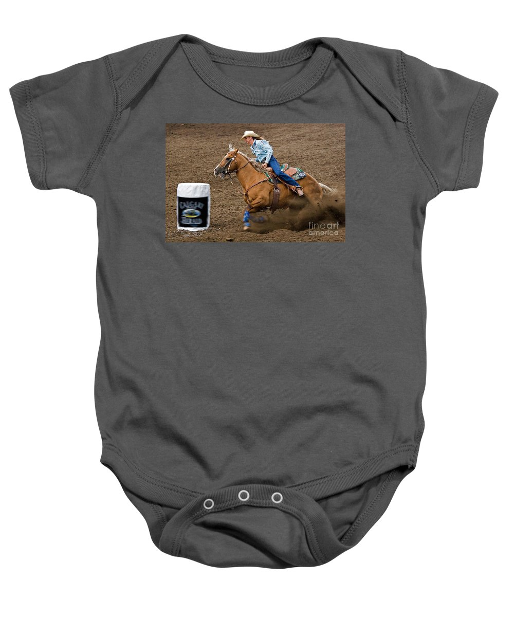 Race Baby Onesie featuring the photograph Barrel Racing by Louise Heusinkveld