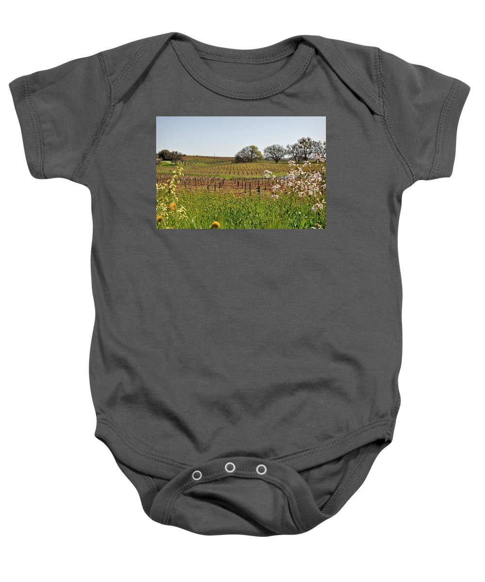 Green Baby Onesie featuring the photograph Beautiful California Vineyard Framed With Flowers by Brandon Bourdages