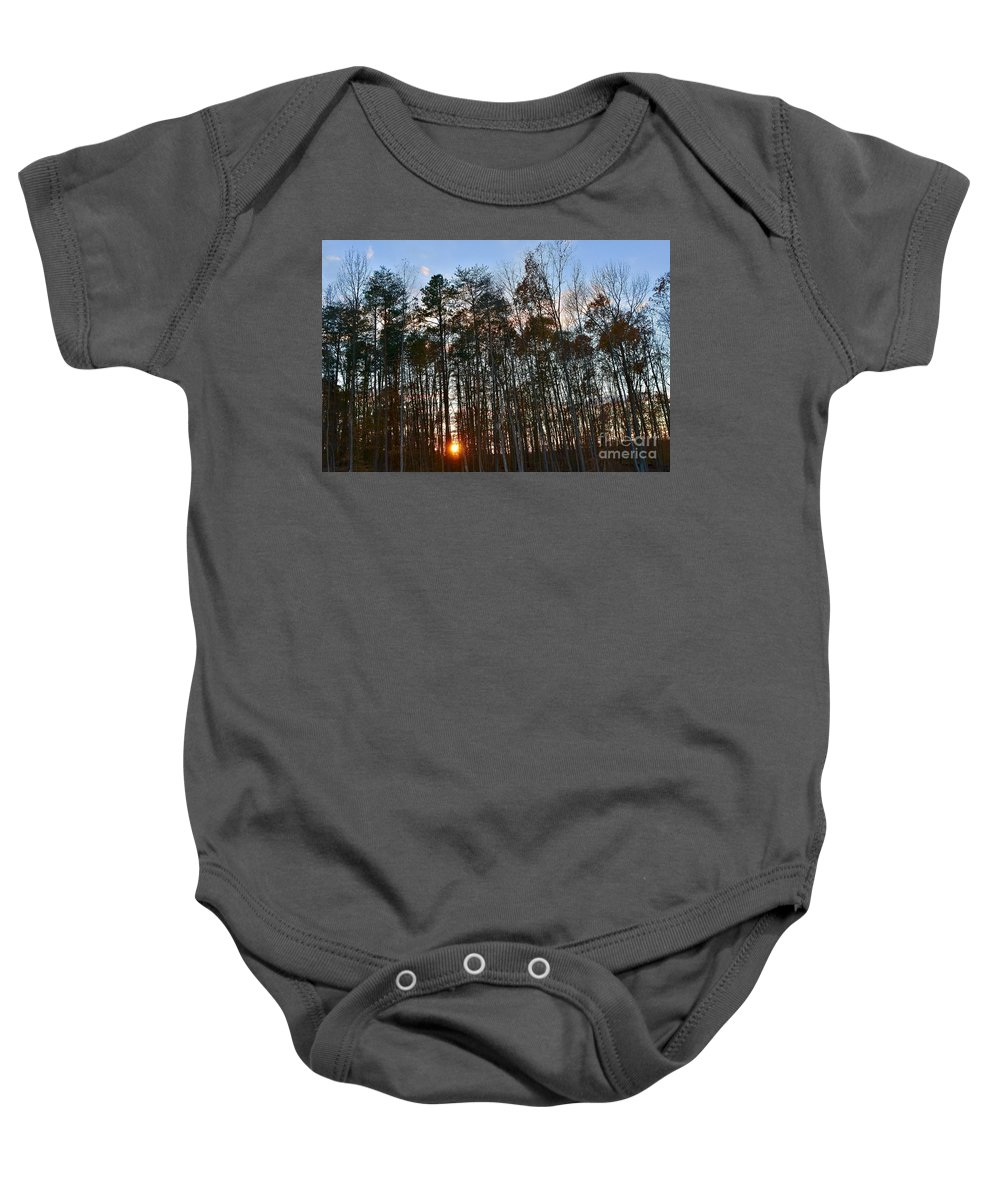 Amazing Sunset Baby Onesie featuring the photograph Behind The Trees by Jeramey Lende