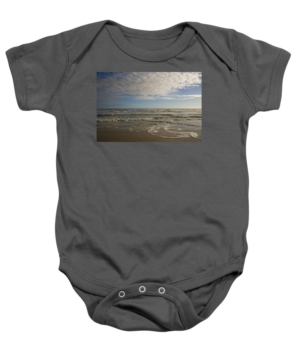 Wave Sand Ocean Beach Sky Water Wave Tide Sun Sunny Vacation Cloud Morning Early Baby Onesie featuring the photograph Between Night And Day by Andrei Shliakhau