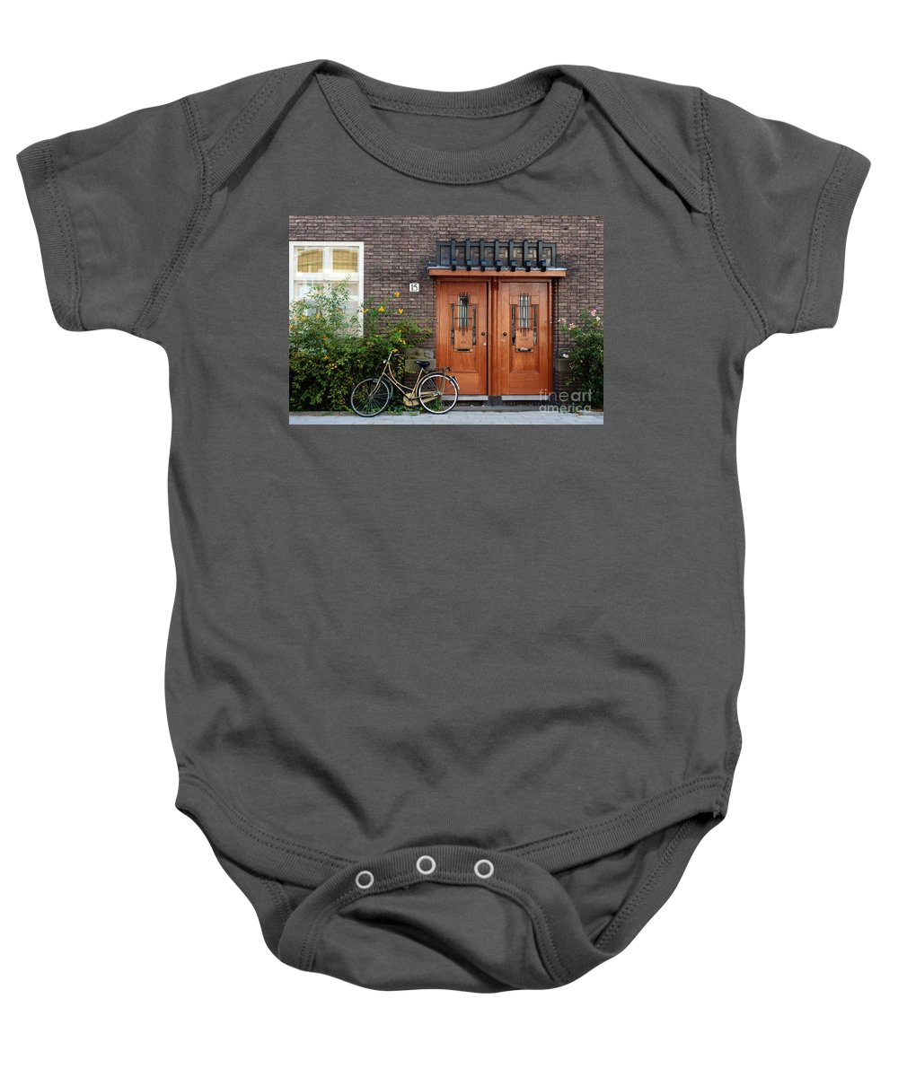 Bicycle Baby Onesie featuring the photograph Bicycle And Wooden Door by Thomas Marchessault