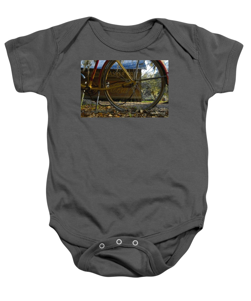 Bicycle Baby Onesie featuring the photograph Bicycle At Micanopy by David Lee Thompson