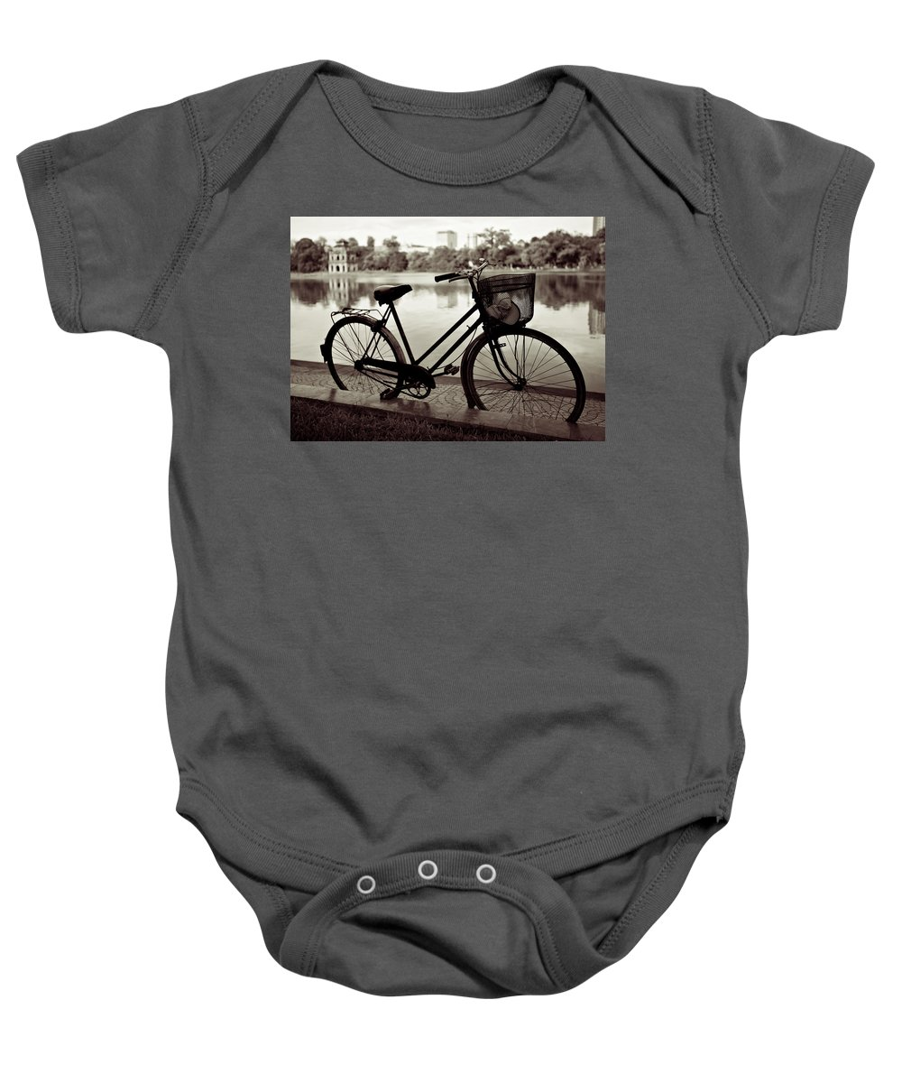 Bicycle Baby Onesie featuring the photograph Bicycle By The Lake by Dave Bowman