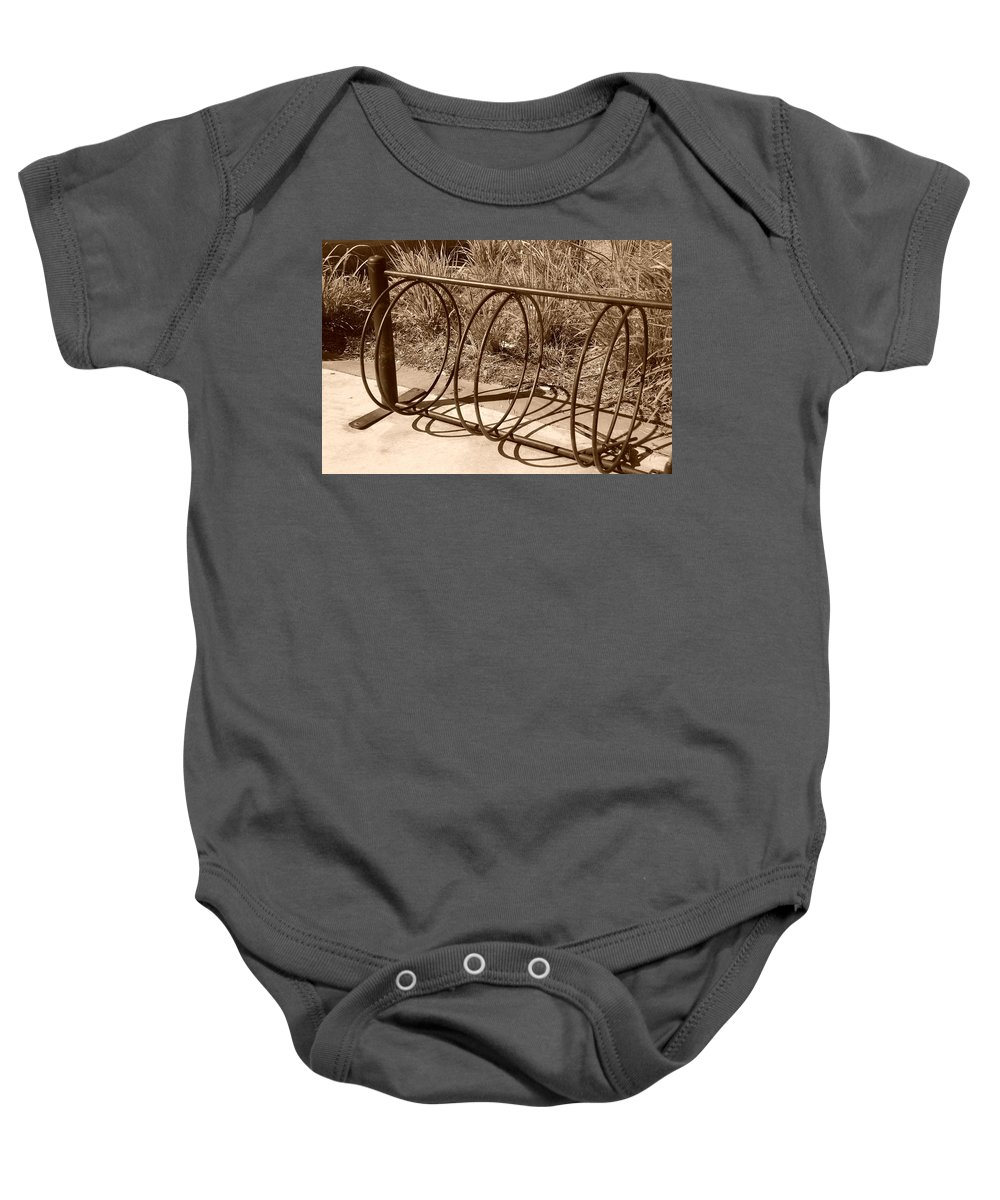 Bicycle Baby Onesie featuring the photograph Bike Rack by Rob Hans