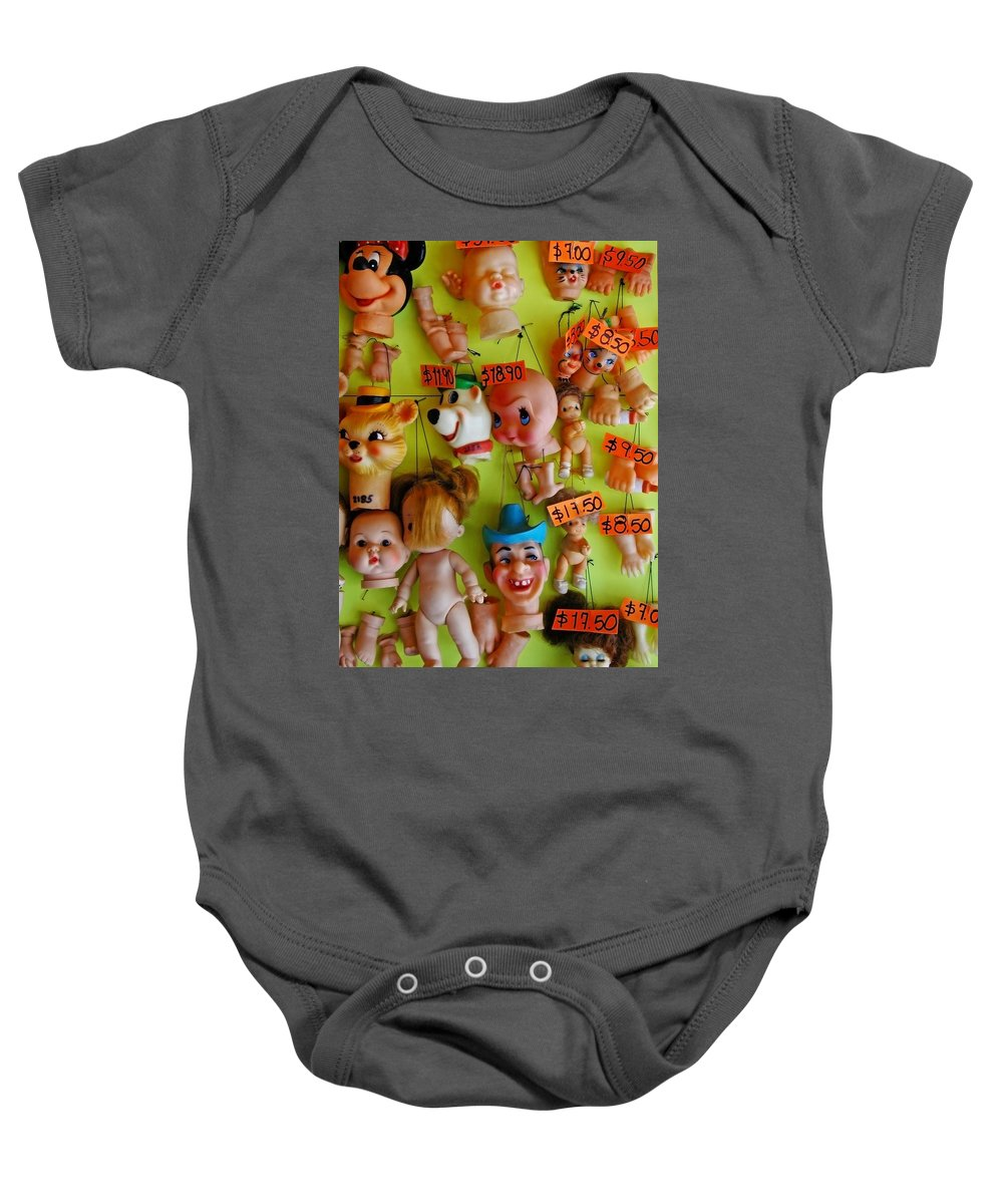 Heads Baby Onesie featuring the photograph Black Market Parts by Skip Hunt