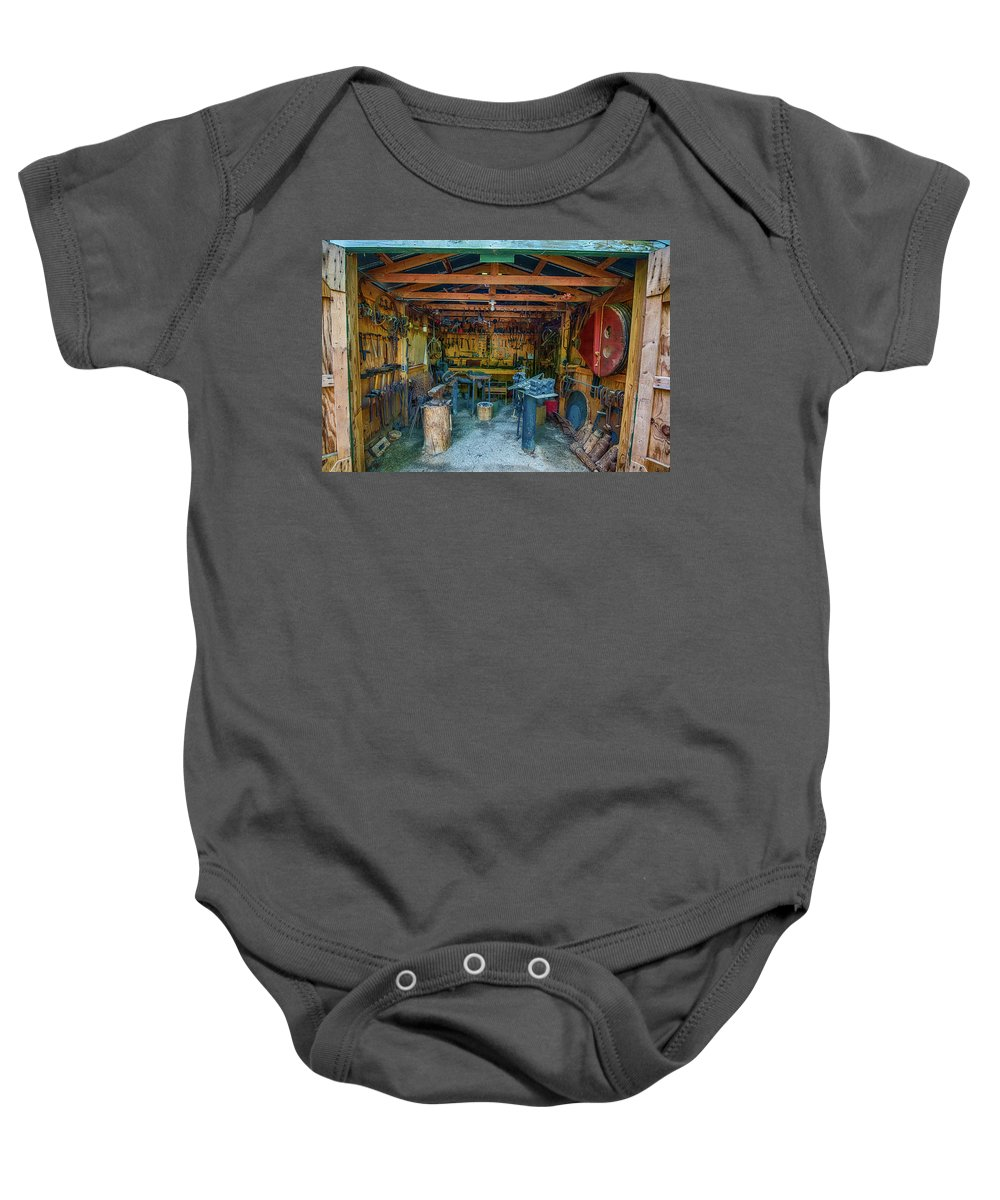 Blacksmith Tools Baby Onesie featuring the photograph Black Smith by Paul Freidlund