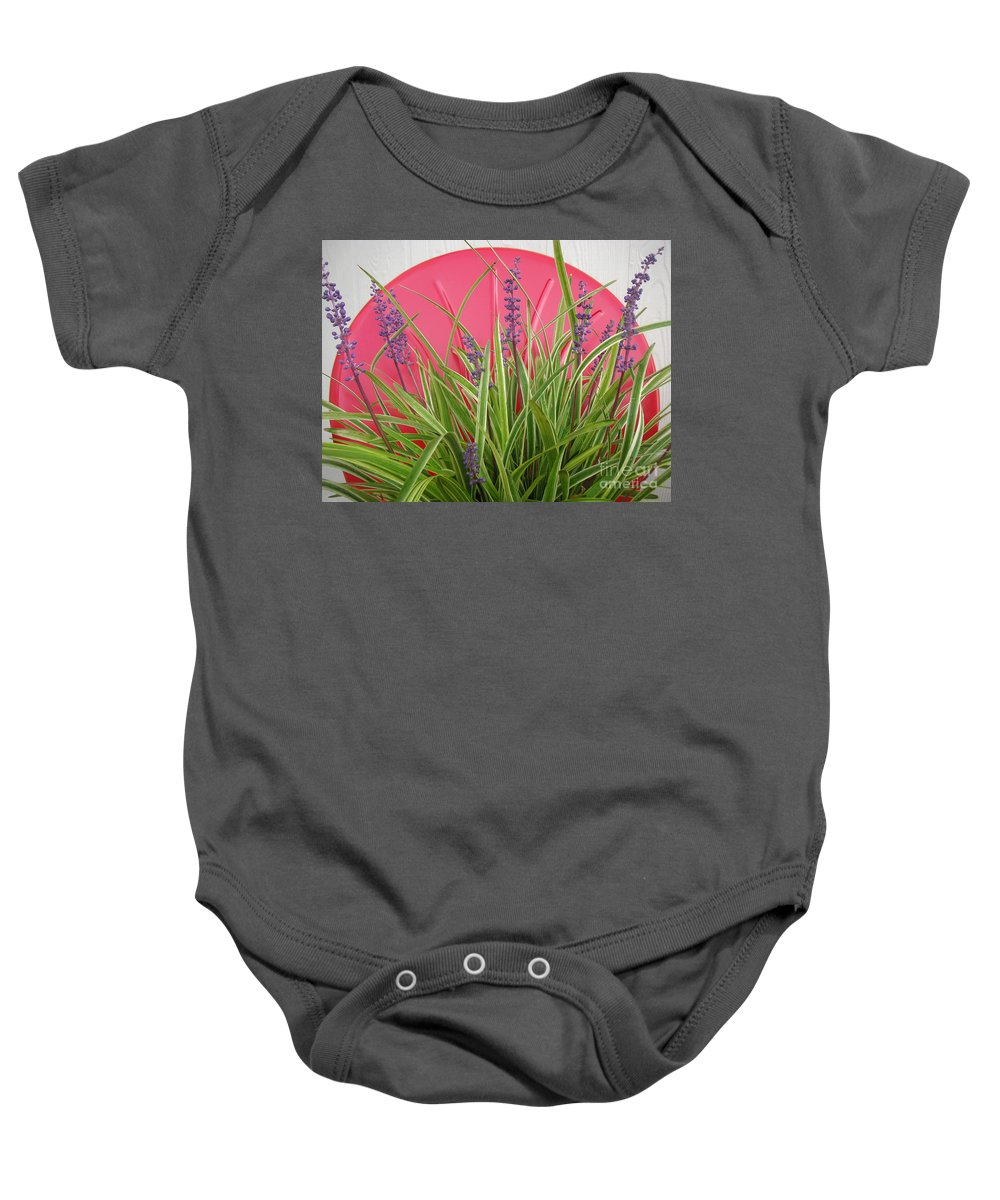 Nature Baby Onesie featuring the photograph Blooming Spider Against Red by Lucyna A M Green