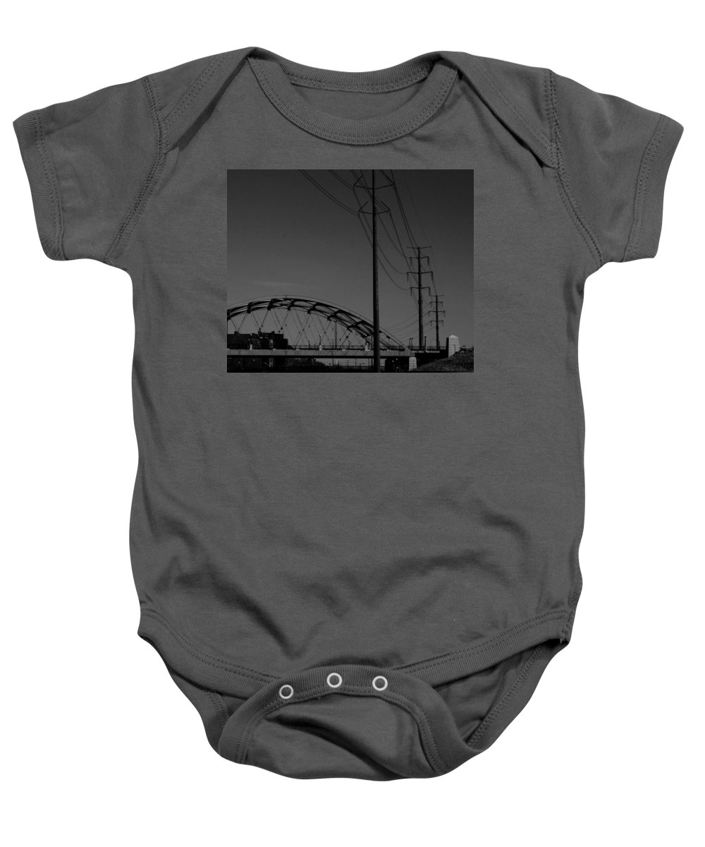 Metal Structures Baby Onesie featuring the photograph Bridge And Power Poles At Dusk by Angus Hooper Iii