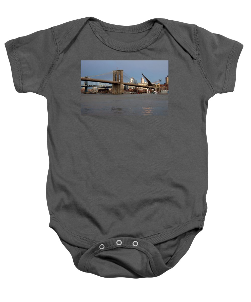 Brooklyn Bridge Baby Onesie featuring the photograph Brooklyn Bridge And Bird In Flight by Anita Burgermeister