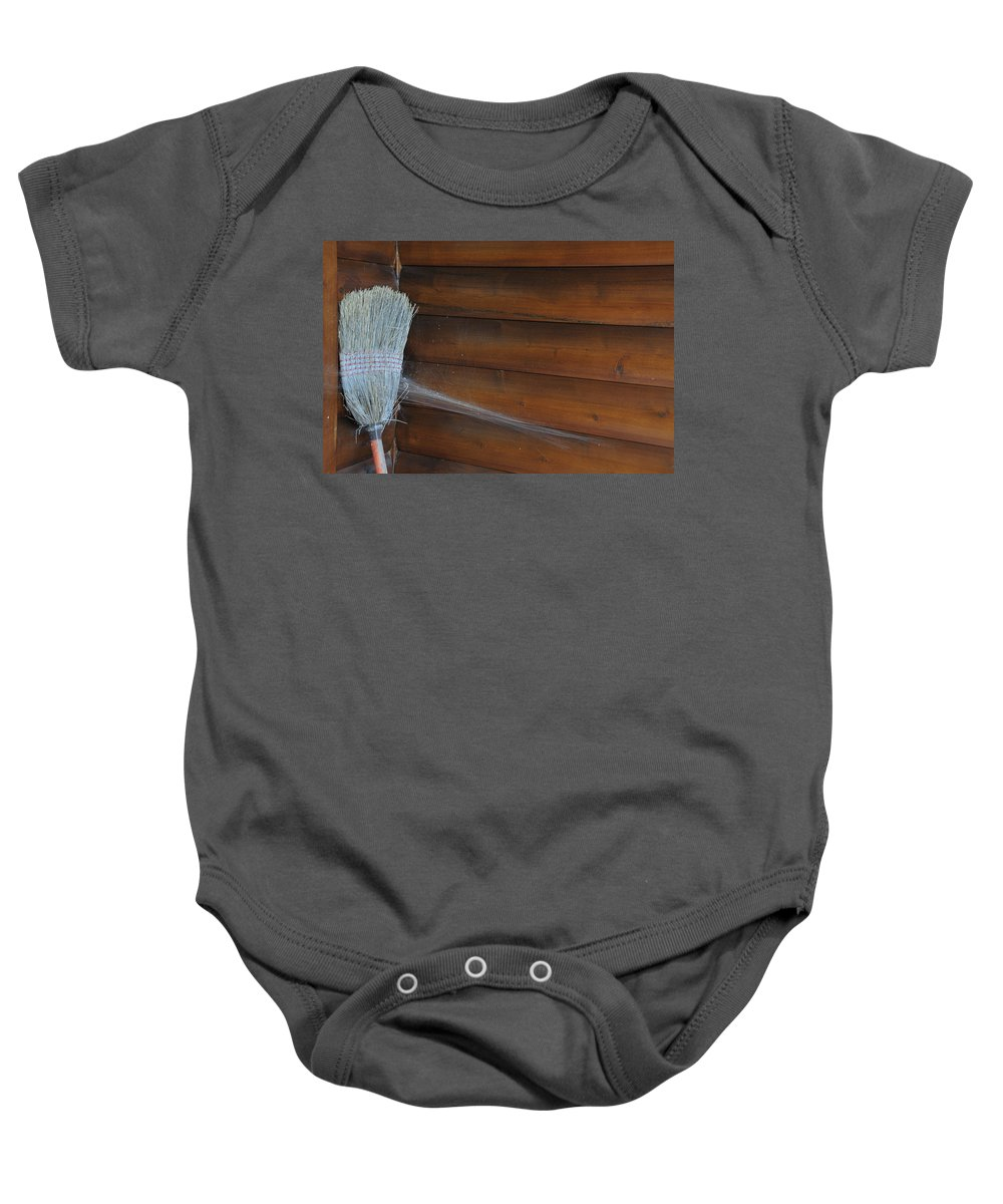 Spider Webs Baby Onesie featuring the photograph Broom In Waiting by David Arment