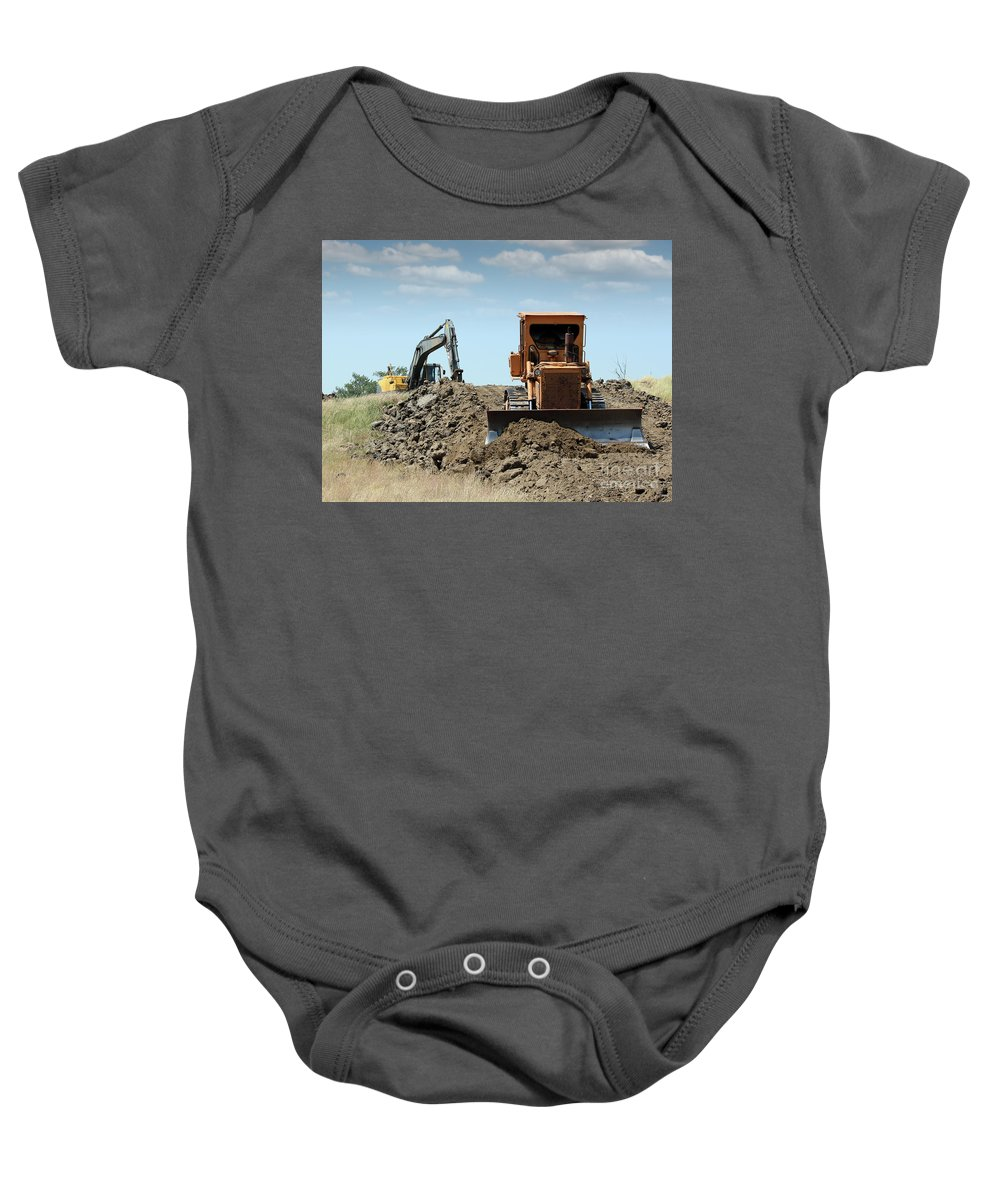 Bulldozer Baby Onesie featuring the photograph Bulldozer And Excavator On Road Construction by Goce Risteski