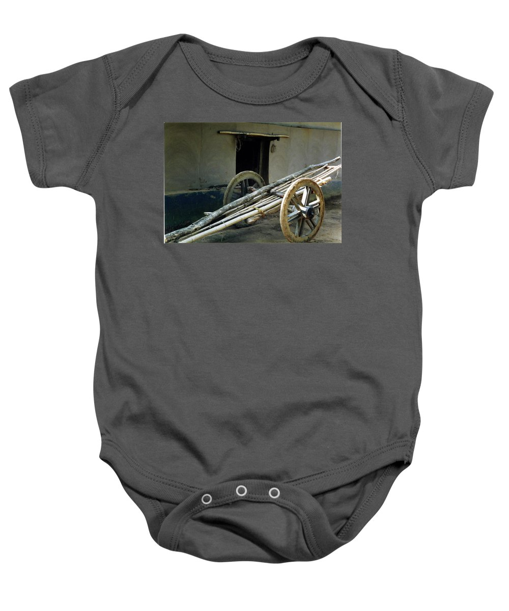 Bullock Cart Baby Onesie featuring the pyrography Bullock Cart by Ujjwal Rout